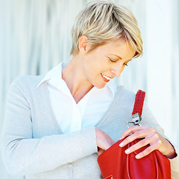 Woman looking in purse