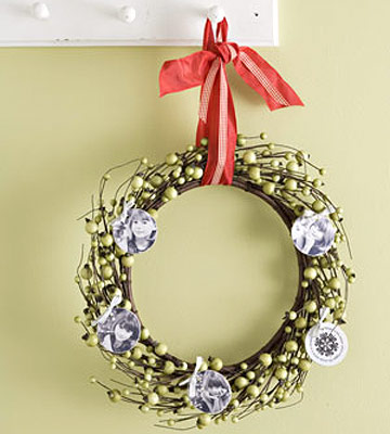 Holiday wreath embellished with circular photos