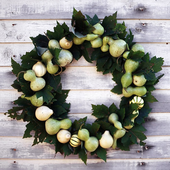 Wreath of green gourds and maple leaves