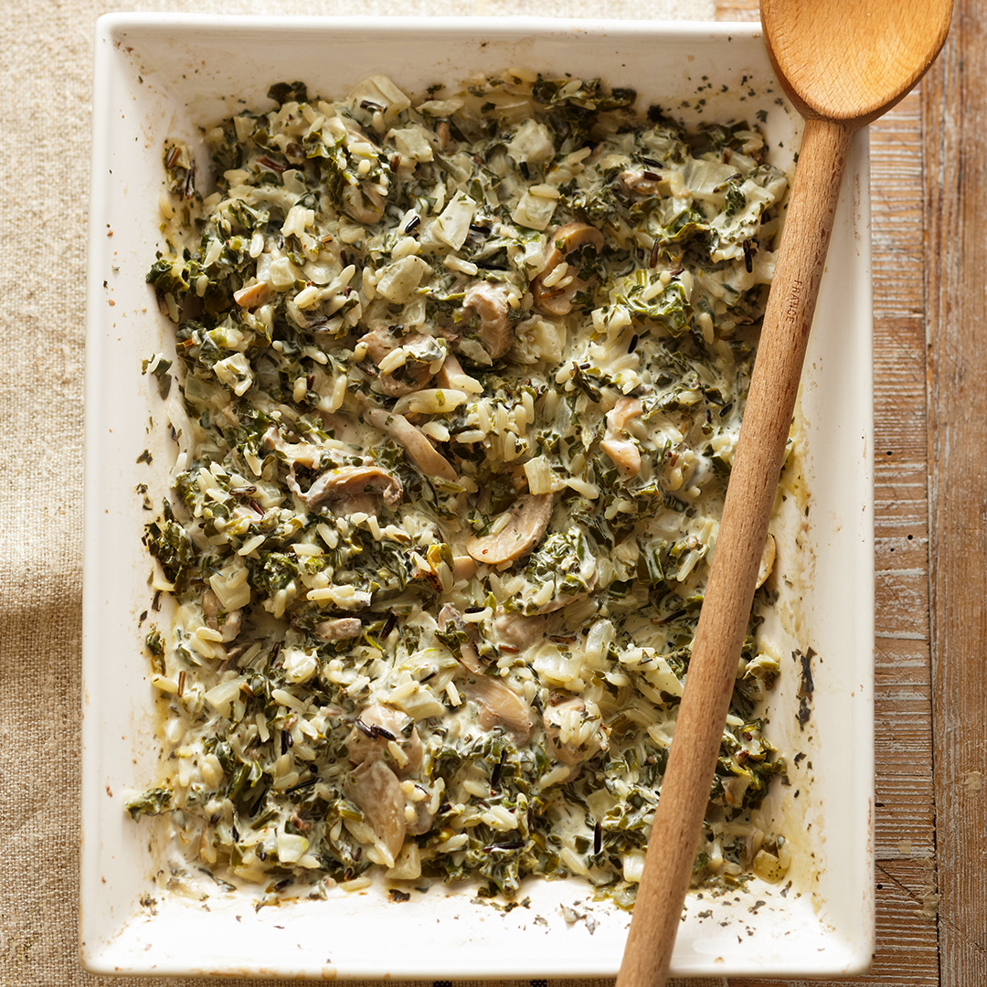 Cheesy Wild Rice Casserole with Wood spoon