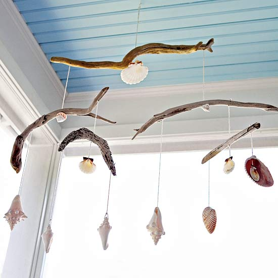 Driftwood and shells hanging from ceiling