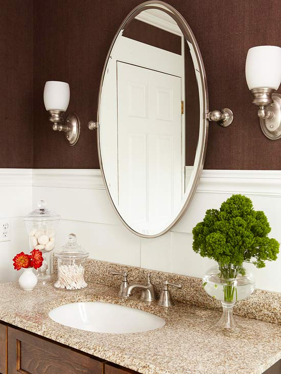 oval mirror over bathroom vanity