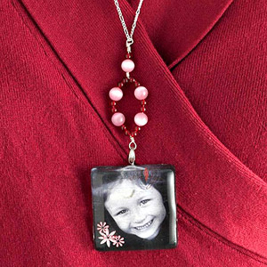 photo necklace on girl with red shirt