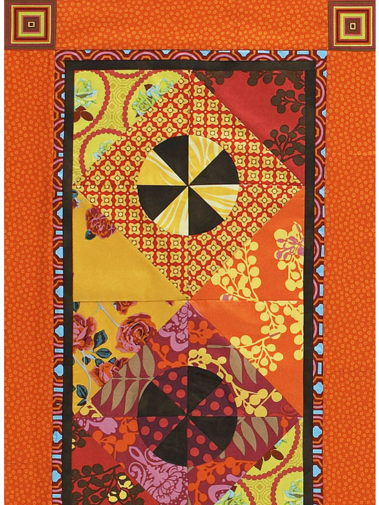 Colorful orange, red, and pink quilt from Anna Maria Horner¿s Garden Party Fabrics