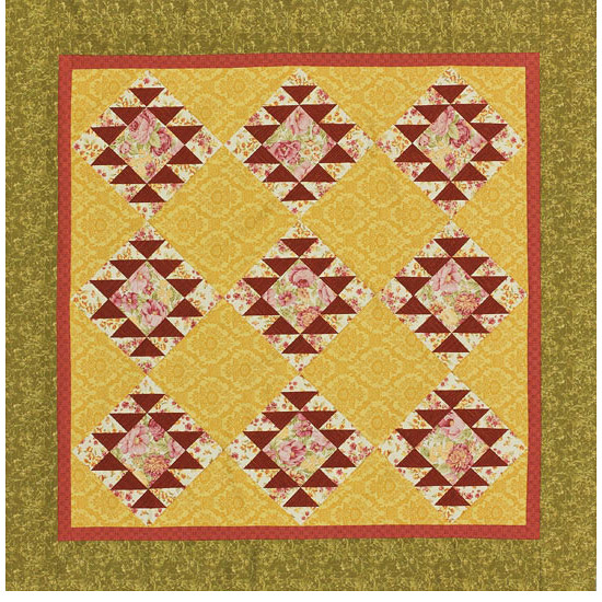 Yellow, green, and red quilt with RJR Fabrics