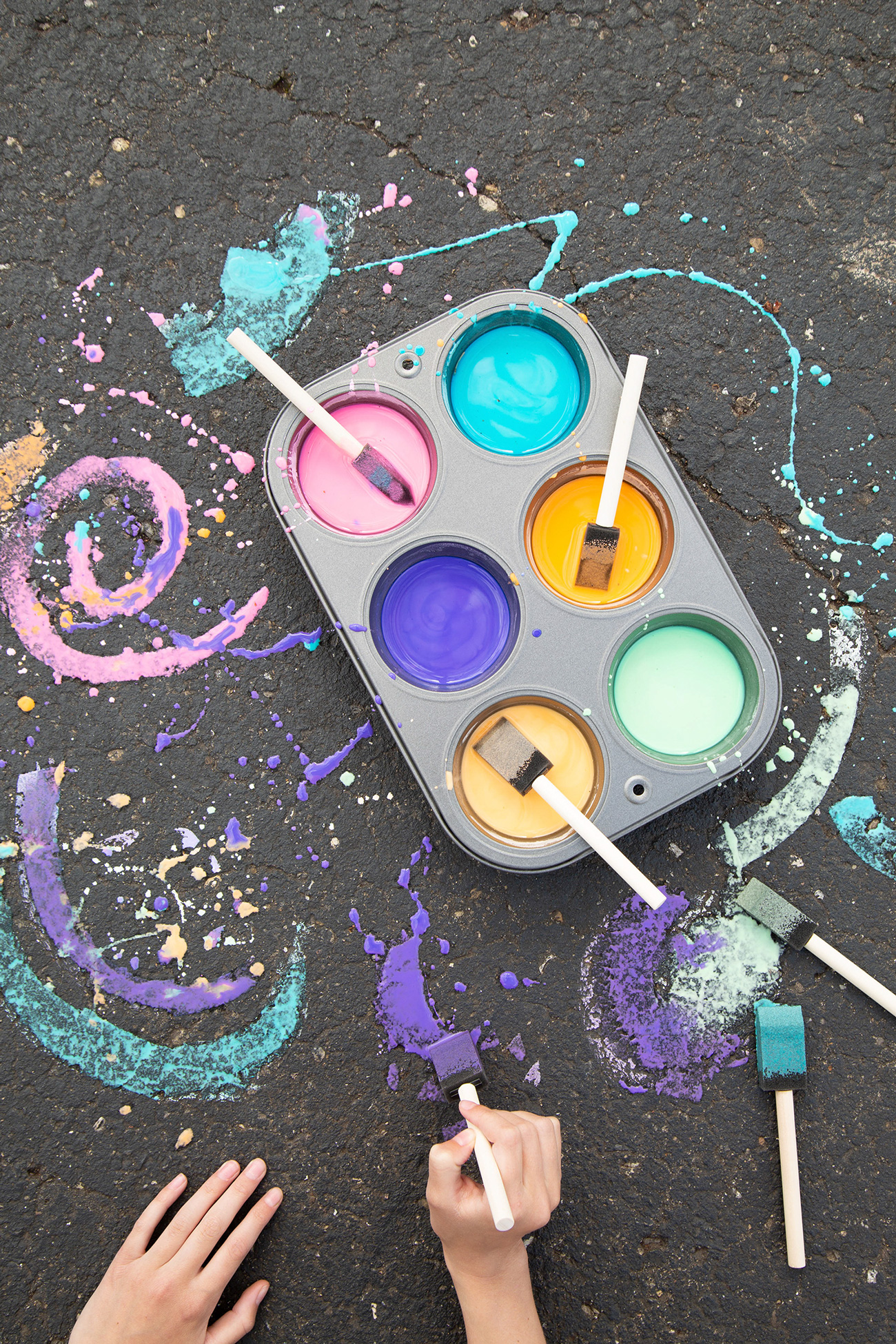 sidewalk paint cupcake tin dark hands painting