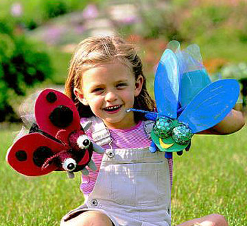 Girl with handmade bug puppets
