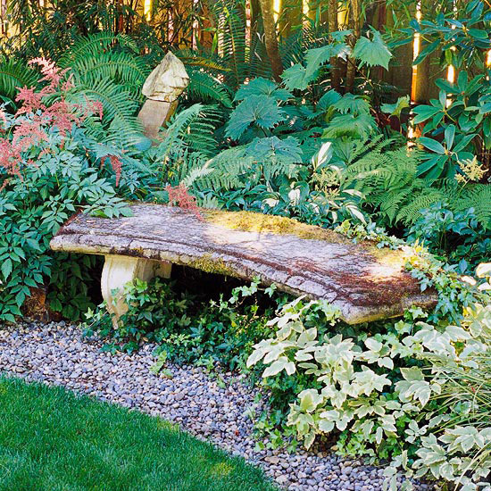 Curved stone bench in garden