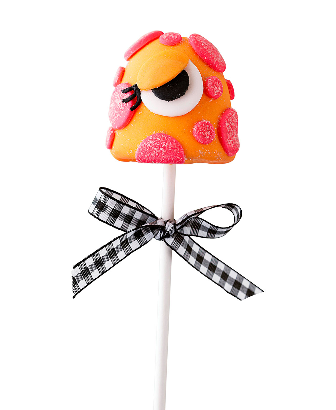 orange-and-pink monster brownie pop with gingham ribbon