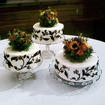 Three individual cakes with dark flower details