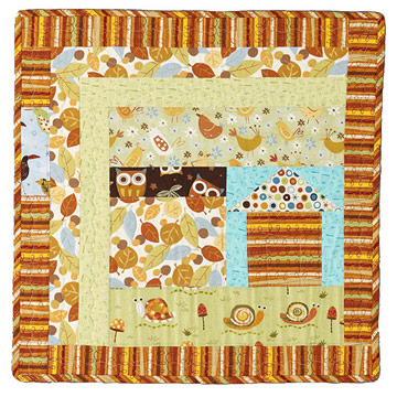 Baby quilt with small characters, piecings in fall colors