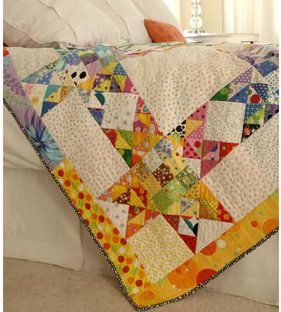Scrap quilt made with vibrant fabrics