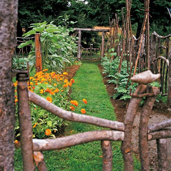 Cavanah vegetable garden showing log fence and arbor