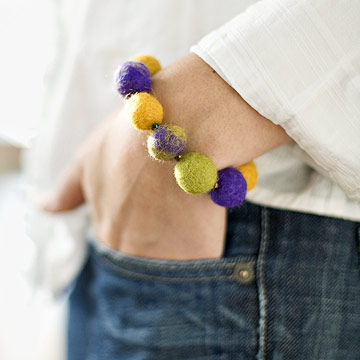 felt bead bracelet hand in pocket