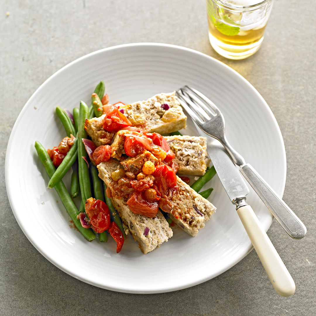 Moroccan Meatloaf on plate with green beans and tomatoes