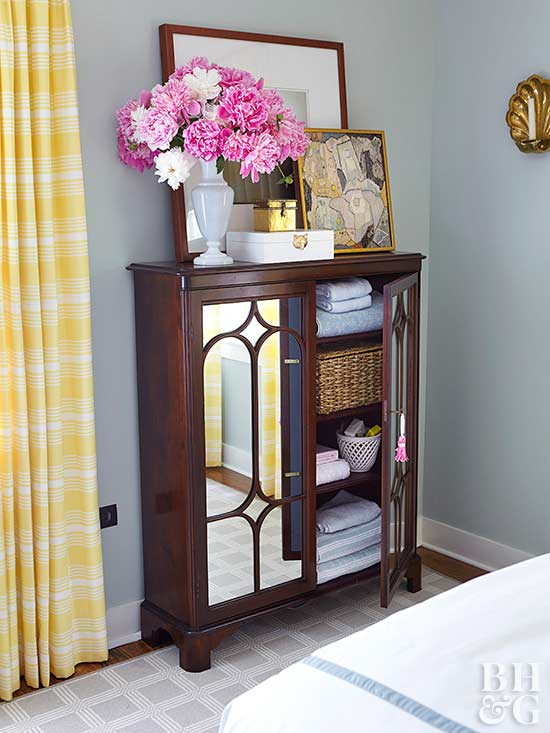 mirrored storage furniture in small bedroom