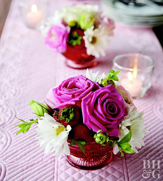 Flowers and strawberries in dessert cups