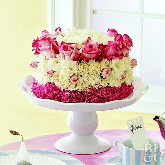 Table setting with flower cake on cake stand