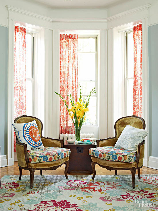 Sunny bay window with two chairs