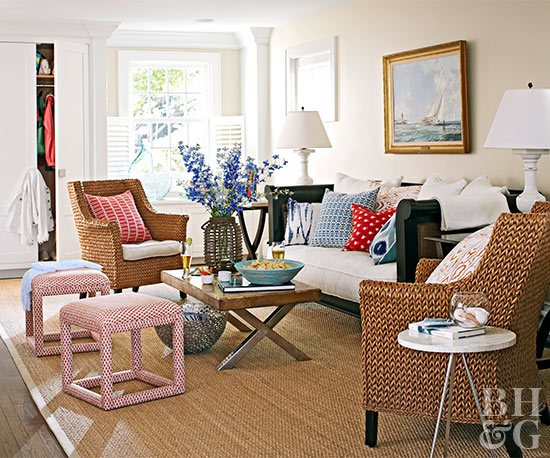 living room with wicker chairs and daybed