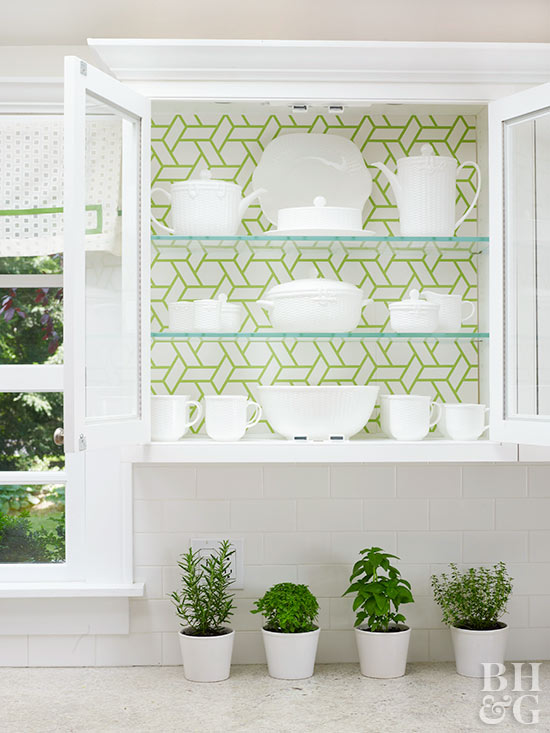 kitchen cabinet with wallpaper backing