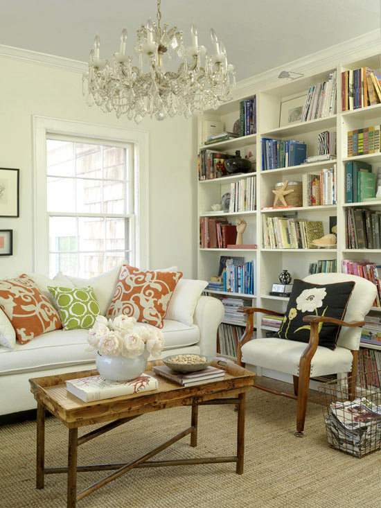 Living room with built-in shelves, bright patterns