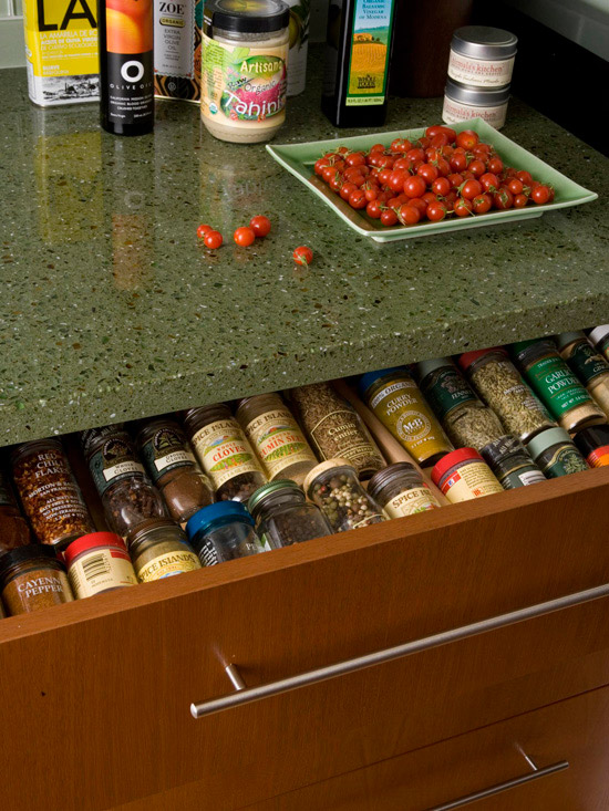 Spice bottles in a shallow drawer
