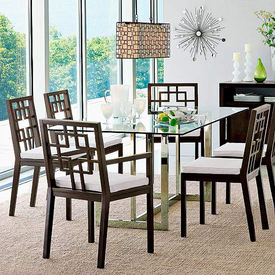 Black geometric chairs at glass table