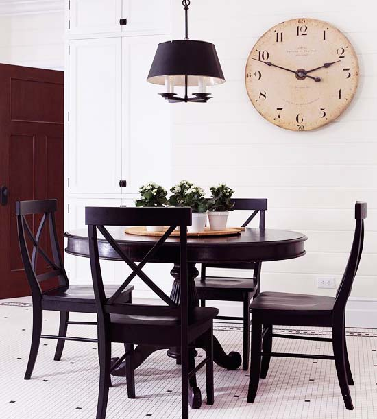 White cloth, black table/chairs