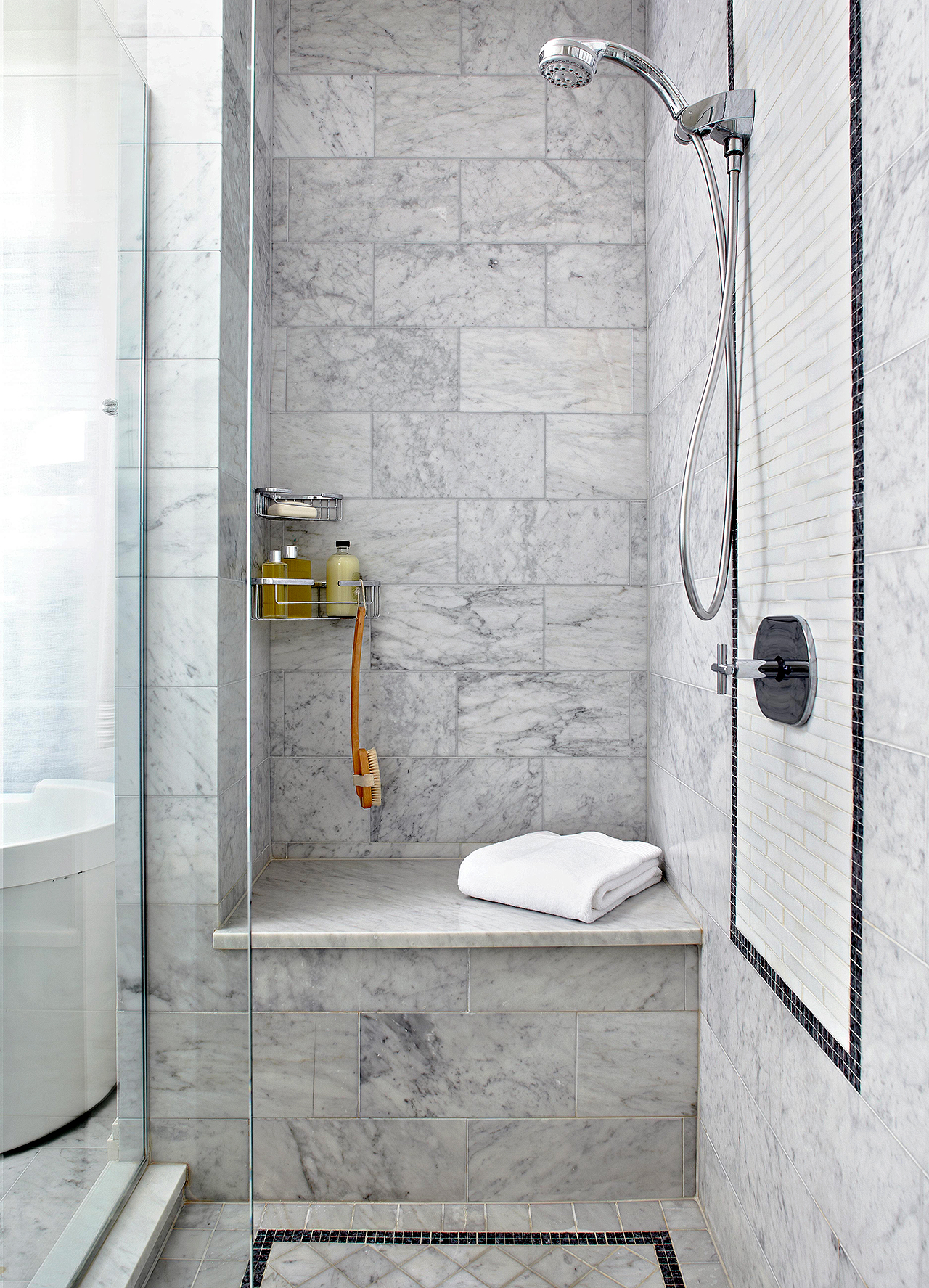 gray tile in shower with built-in bench