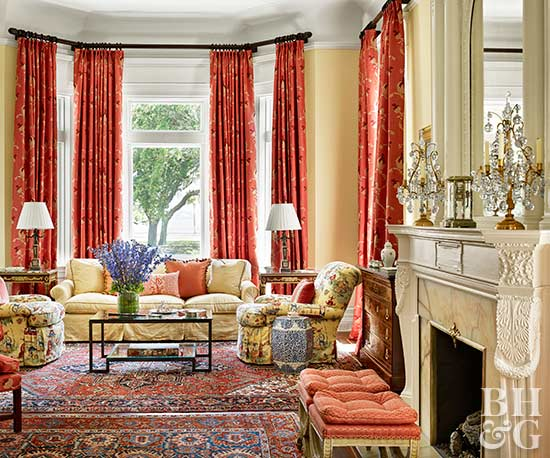 traditional living room with bold red curtains