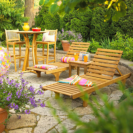 Cedar chaise lounges and patio table