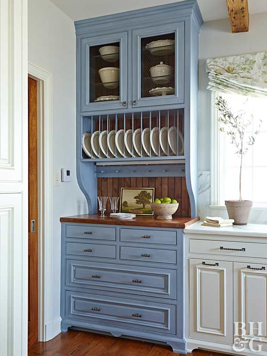 blue and white kitchen, plates, cabinet
