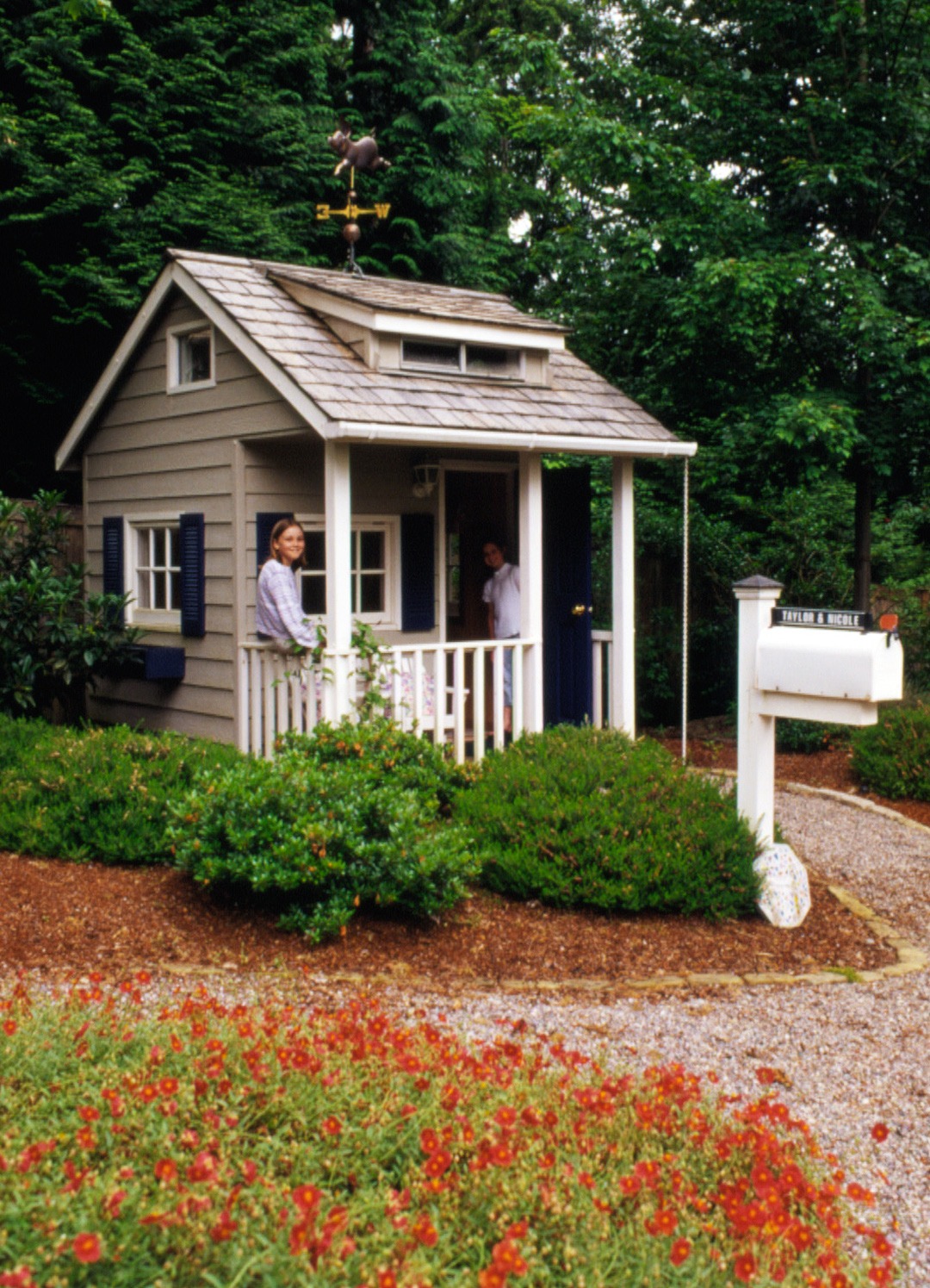 Playhouse with mailbox and shrubs