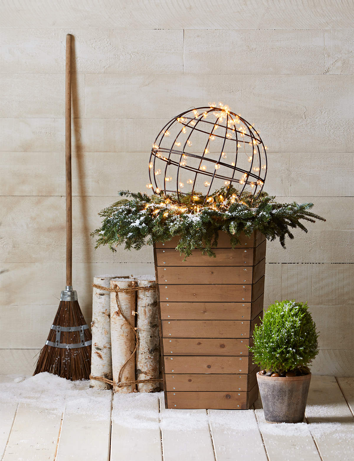 wreath on planter with string light ball