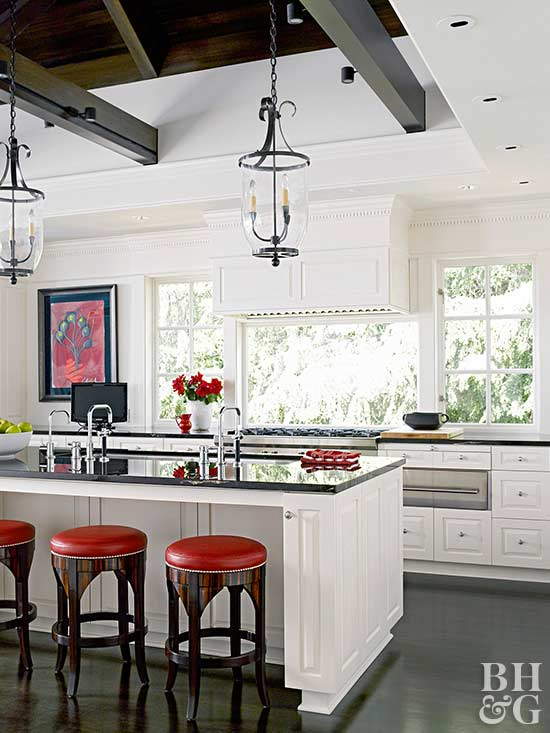 traditional white kitchen with red and black accents