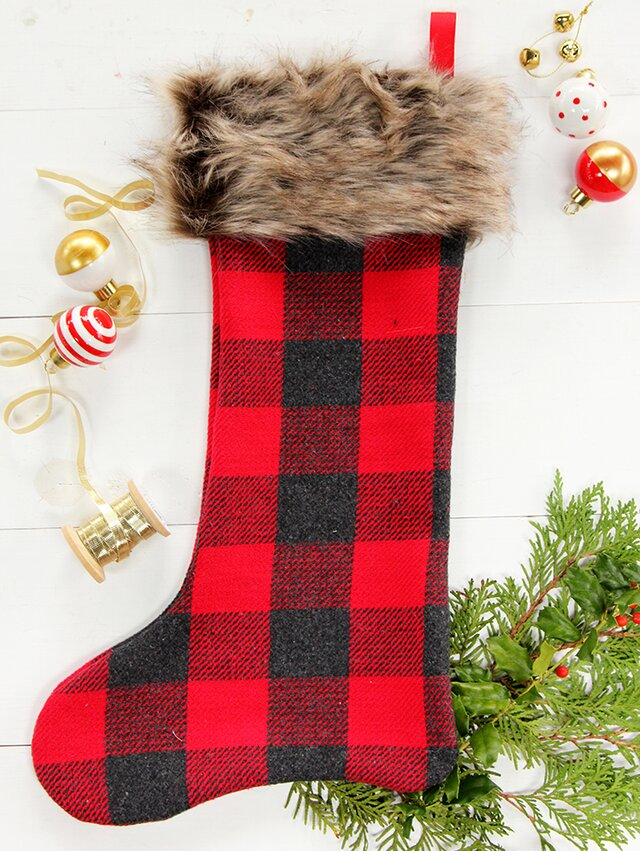 61382b220bc A few simple stitches is all it takes to make these handmade Christmas  stockings. Add a faux fur trim to complete the cozy look.