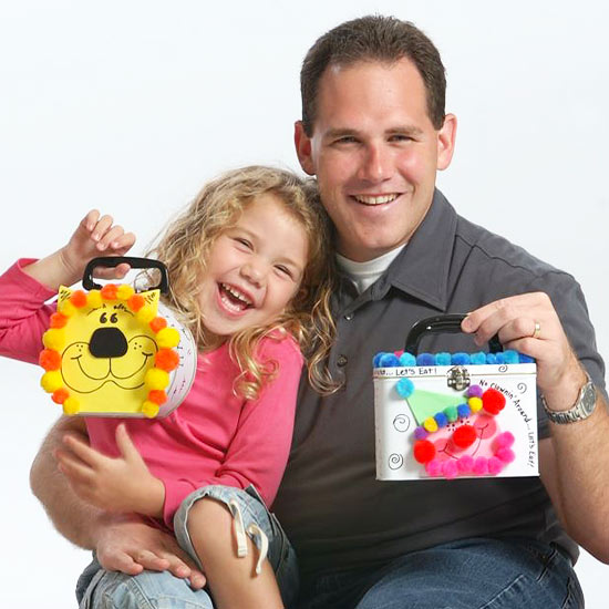 Man and girl with decorated lunch boxes