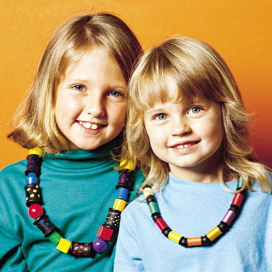 Two girls with beaded necklaces