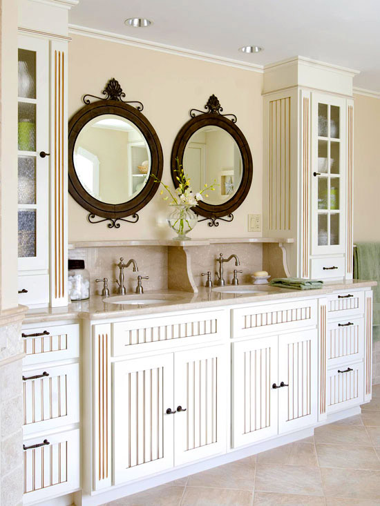 Round mirrors over beaded-board cabinets