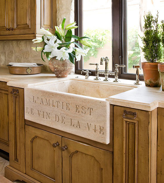 Farm sink with traditional style cabinetry and french text