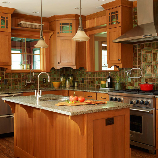 Wood cabinets, green/browns tile