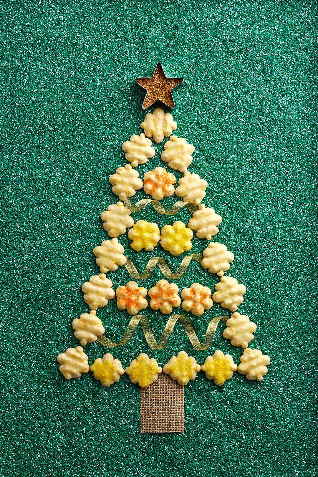 Lemon-Clementine Spritz Cookies arranged in christmas tree shape