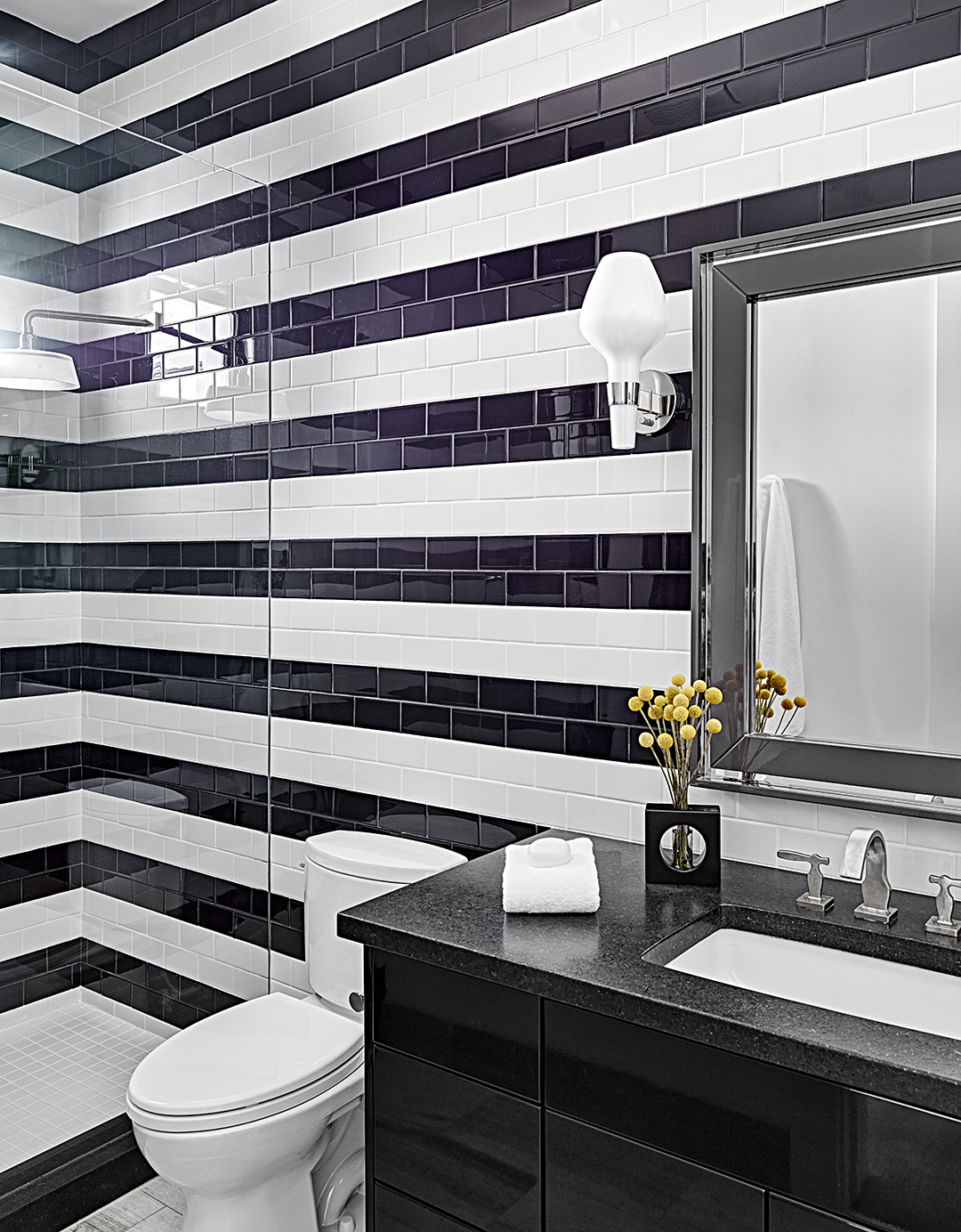 bathroom with black and white tiles