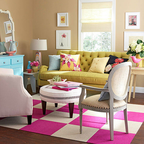 Yellow living room with pink area rug