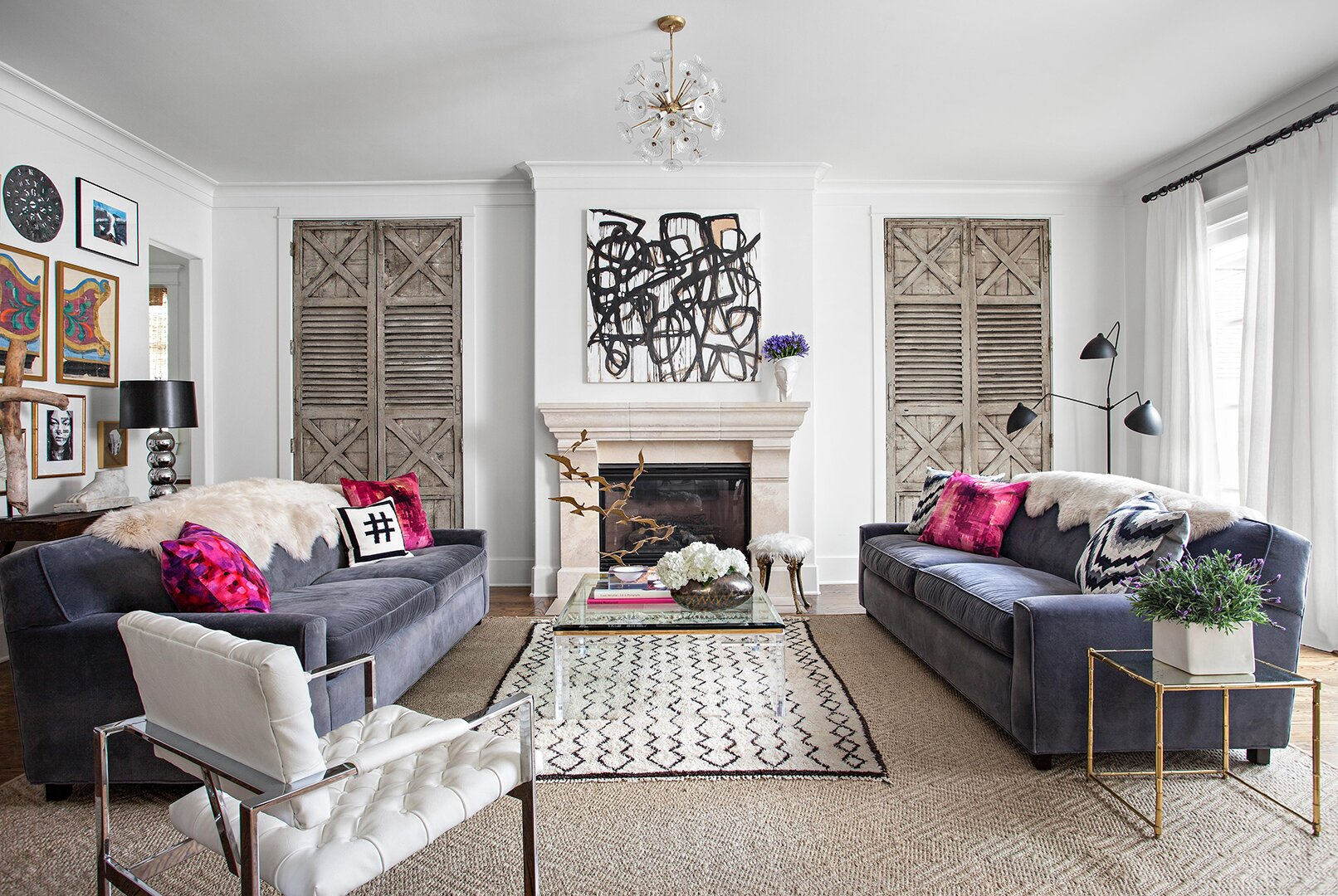 neutral toned living room with hot pink accent pillows and modern art painting