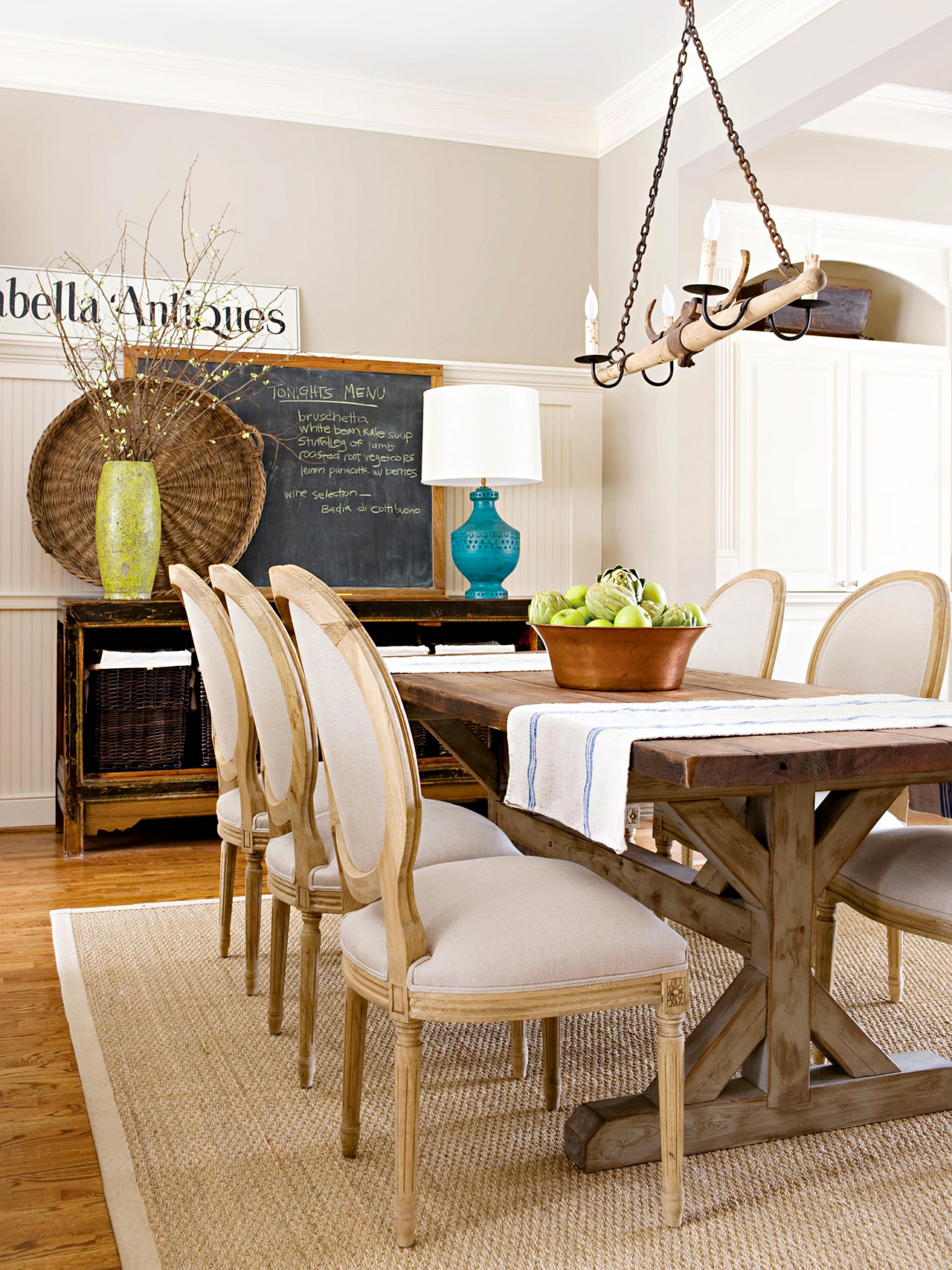 rustic dining room with neutral colors and sisal rug
