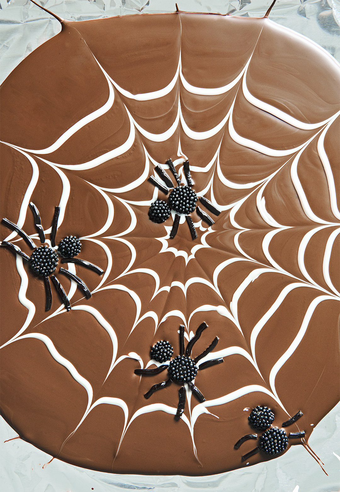 Creepy Cobweb Chocolate Bark with candy spiders