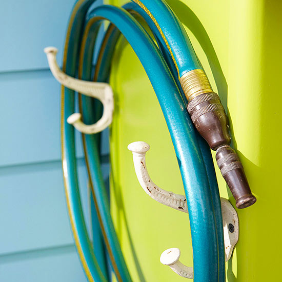 Coat hooks used for garden hose storage