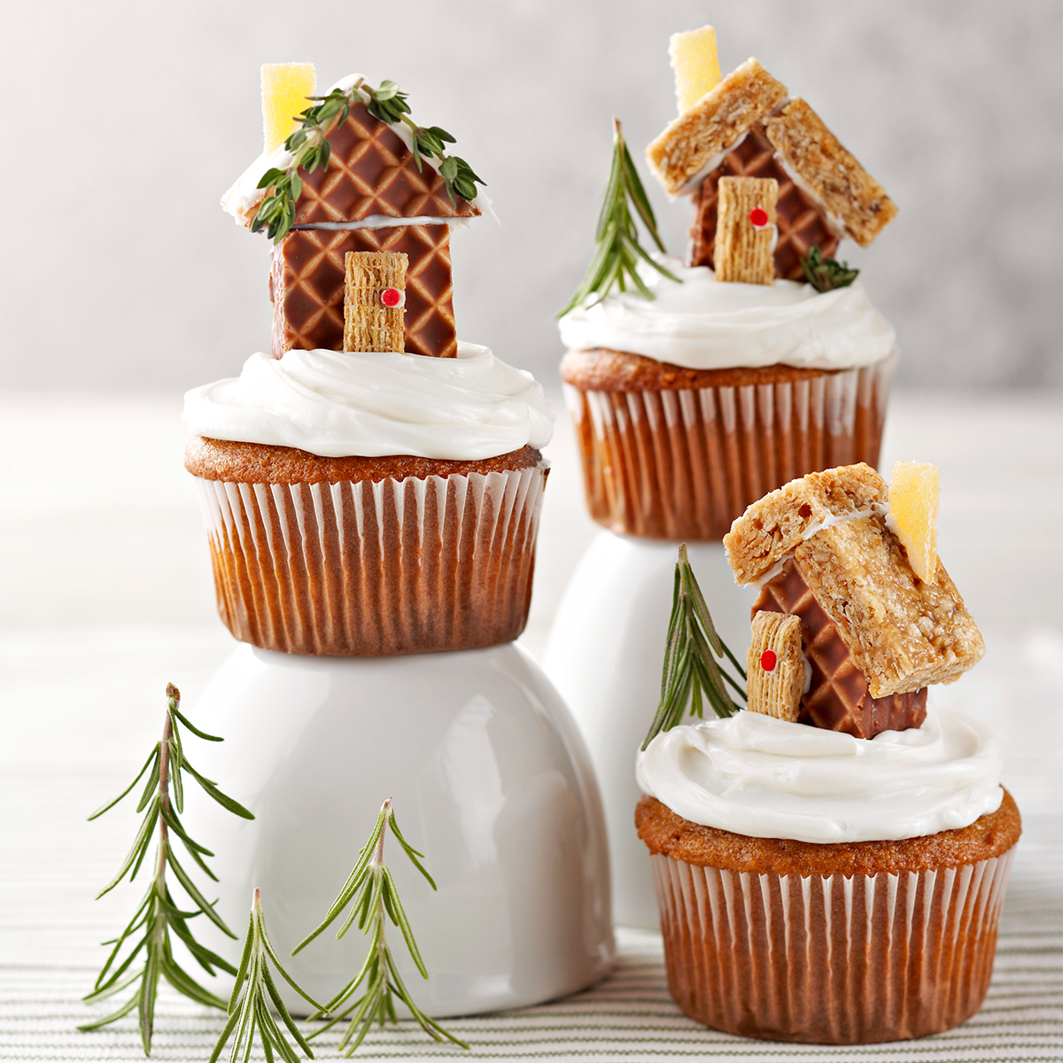three Mini Gingerbread House Cupcakes with different house toppers